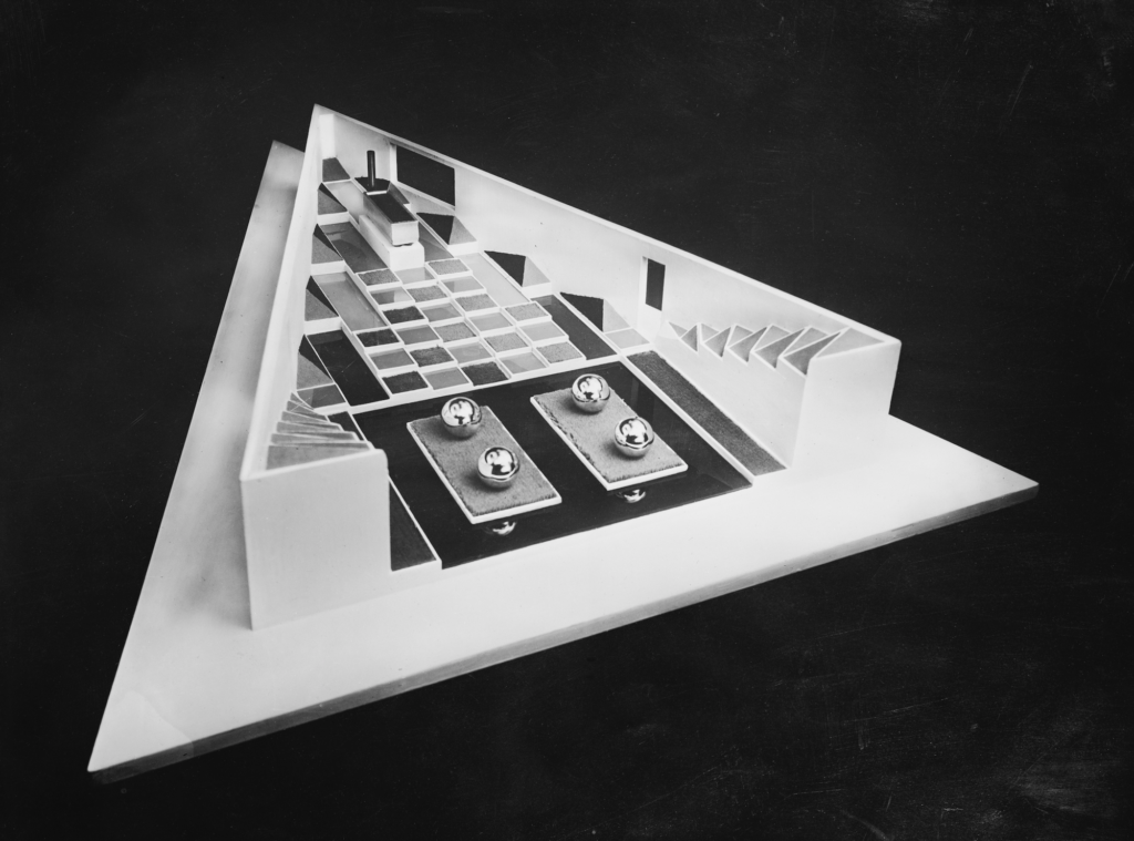 Black and white photo of a triangular model.